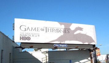 Shadow of the dragon on a billboard